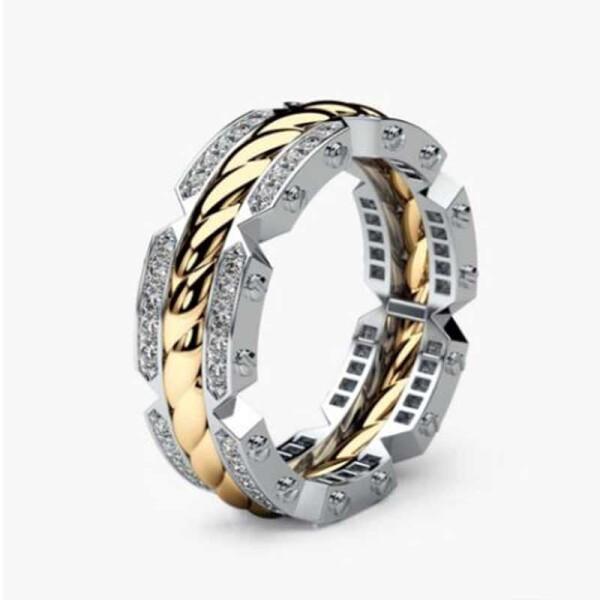 Двухцветное кольцо «Gedeon» красивого дизайна с мелкими фианитами купить. Цена 199 грн