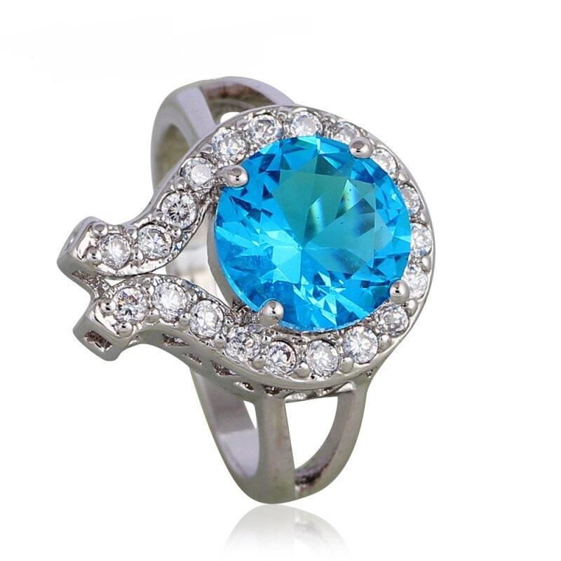 Изумительное кольцо «Мелодия Океана» с голубым цирконом и платиновым покрытием купить. Цена 199 грн