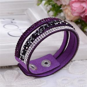 Яркий браслет «Фристайл» фиолетового цвета в виде трёх полос, усыпанных стразами фото. Купить