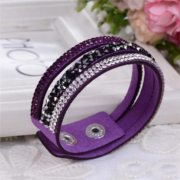 Яркий браслет «Фристайл» фиолетового цвета в виде трёх полос, усыпанных стразами купить. Цена 89 грн