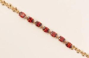 Красивый браслет «Меринда» с красными цирконами в позолоченной оправе купить. Цена 285 грн