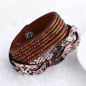 Комбинированный длинный браслет «Анаконда» со вставкой под змеиную кожу и коричневыми стразами купить. Цена 99 грн или 310 руб.