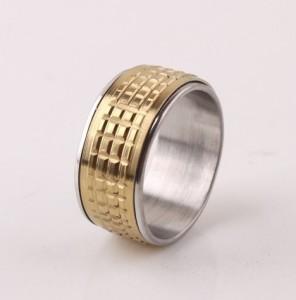 Широкое стальное кольцо «Gedeon» с подвижной вставкой золотого цвета с квадратной насечкой купить. Цена 165 грн
