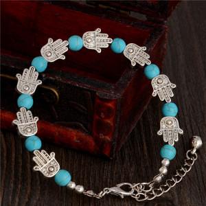 Тибетский браслет со звеньями в виде ладоней, чередующихся с бусинами из бирюзы фото. Купить