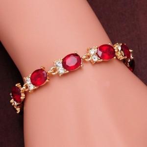 Нарядный браслет «Кабаре» в классическом стиле с красными камнями в оправе под золото купить. Цена 125 грн или 395 руб.