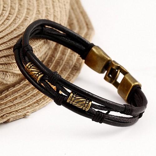 Индейский браслет «Апачи» из чёрных кожаных и вощёных шнурков с бронзовыми вставками купить. Цена 89 грн