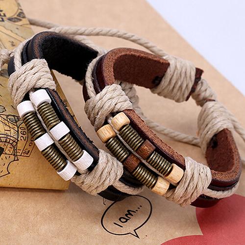 Недорогой кожаный браслет с деревянными бусинами и верёвками-затяжками купить. Цена 79 грн