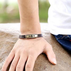 Коричневый браслет из кожи с бронзовой планкой с изображением креста фото 1