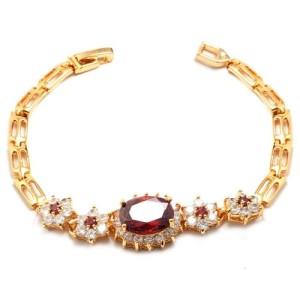 Неповторимый браслет «Аврелия» с рубиново-красными фианитами, бесцветными цирконами и позолотой фото. Купить