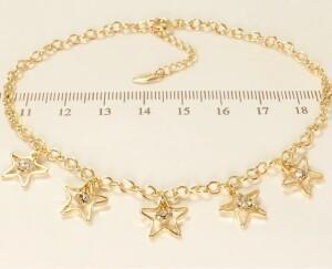 Модный браслет-цепочка на ногу с висюльками в форме звёзд и качественной позолотой фото. Купить