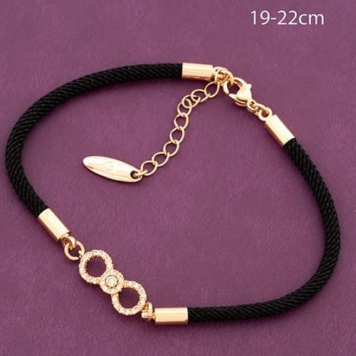 Комбинированный браслет «Восьмёрочка» из чёрной нити и позолоченных вставок купить. Цена 199 грн
