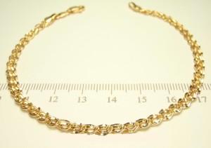 Утончённый позолоченный браслет с плетением двойное ромбо с изогнутыми звеньями купить. Цена 189 грн или 595 руб.