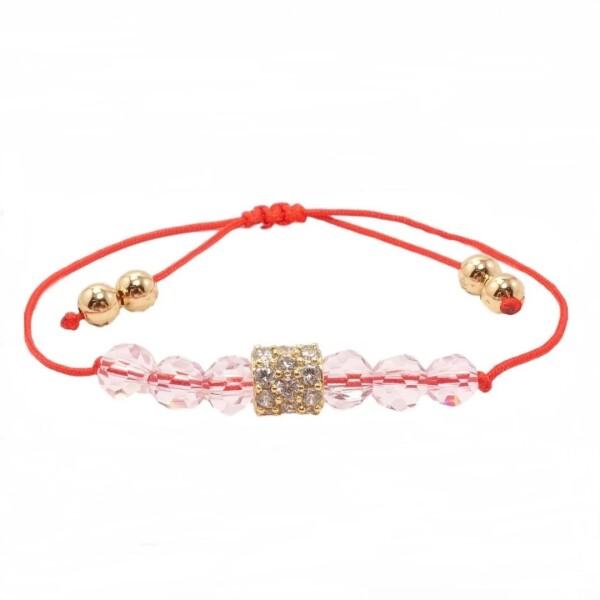 Красный браслет «Макарена» с хрустальными бусинами и позолоченным шармиком купить. Цена 265 грн
