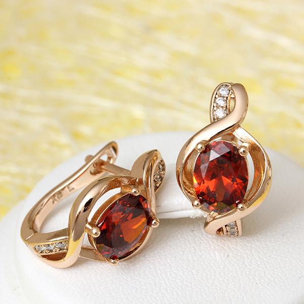 Оригинальные серьги «Мелодия» с красными и бесцветными камнями в позолоте купить. Цена 175 грн