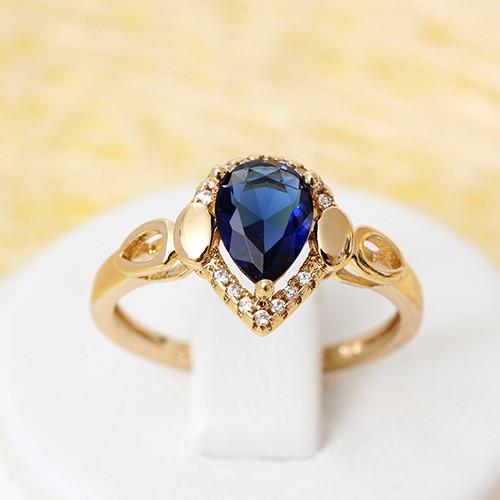 Незабываемое кольцо «Страсть» с каплевидным синим камнем в позолоте купить. Цена 185 грн