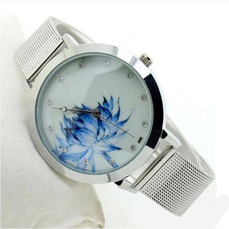 Нежные женские часы «Geneva» с изображением лотоса на циферблате купить. Цена 299 грн