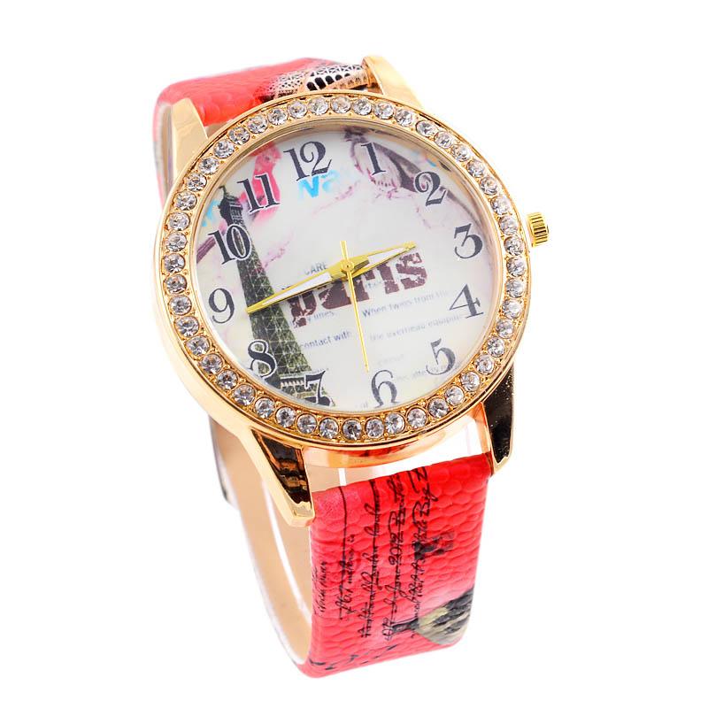 Яркие часы «Quartz» с Эйфелевой башней на циферблате, стразами и цветным ремешком купить. Цена 235 грн