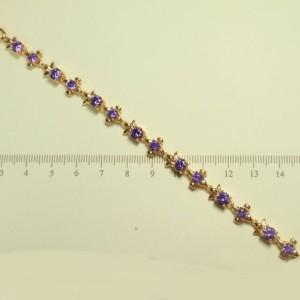 Неотразимый позолоченный браслет «Династия» с круглыми цирконами фиолетового цвета купить. Цена 375 грн
