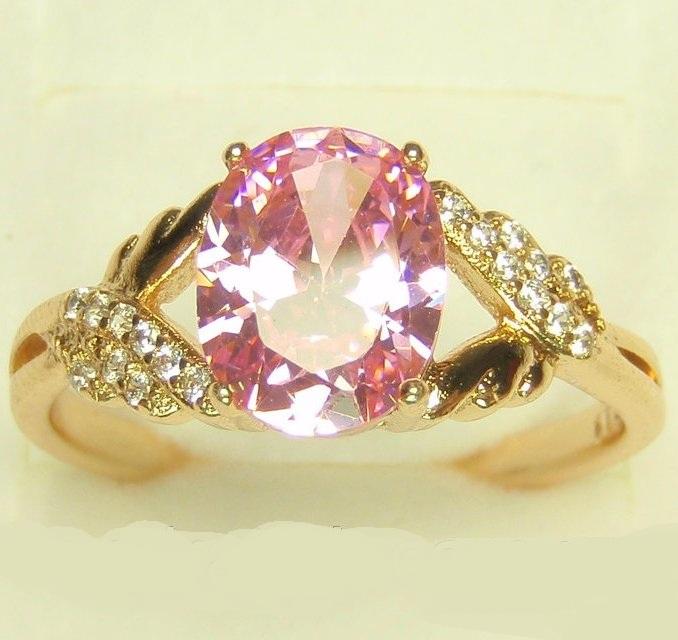 Покрытое золотом кольцо «Монтеки» с розовым цирконом в оправе из маленьких фианитов купить. Цена 185 грн