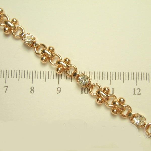 Необыкновенный позолоченный браслет «Идальго» с цирконами и звеньями интересной формы купить. Цена 210 грн