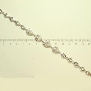 Благородный браслет «Эсферо» с каплевидными цирконами в платиновой оправе фото. Купить