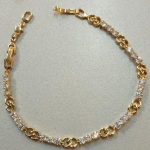 Красивый браслет «Юнона» с небольшими круглыми цирконами и золотым напылением купить. Цена 350 грн