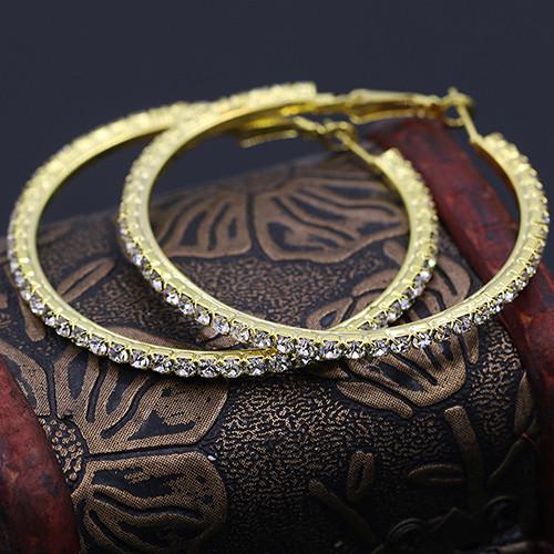 Среднего размера серьги-кольца с камнями и покрытием под золото купить. Цена 89 грн