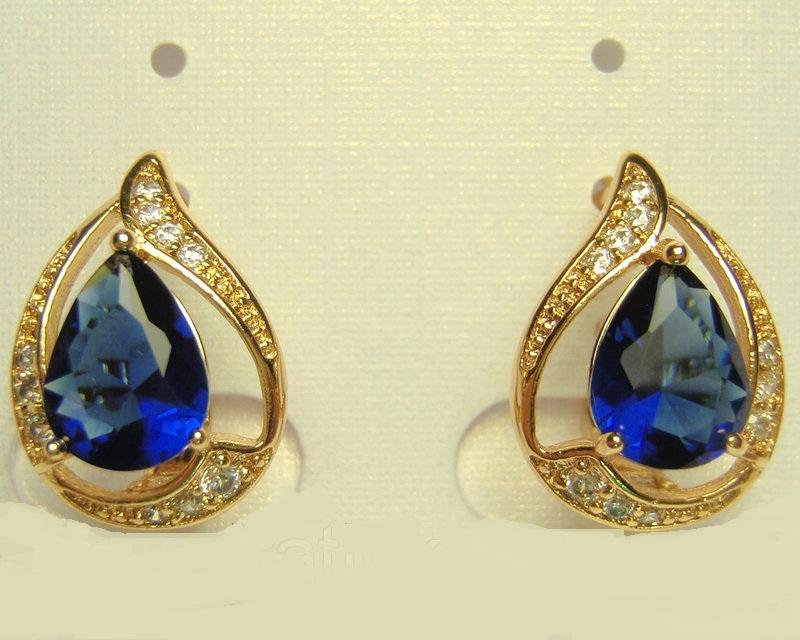 Обаятельные серьги «Огонёк» с синим фианитом и золотым покрытием купить. Цена 155 грн