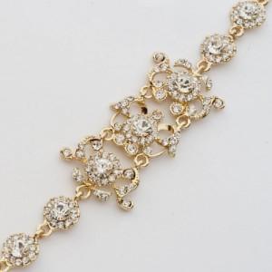 Праздничный браслет «Бальный» с белыми камнями в оправе золотого цвета фото. Купить