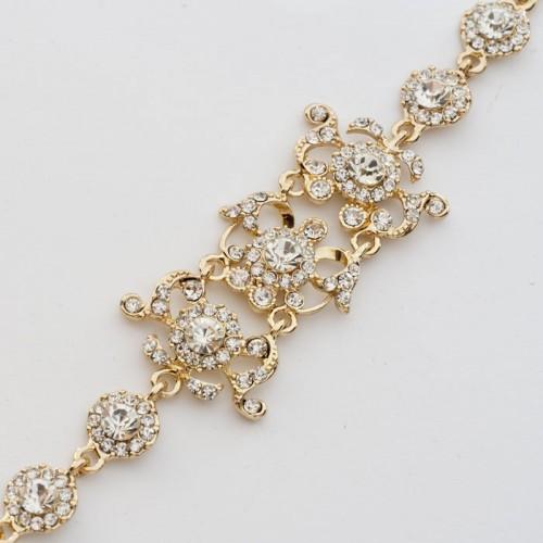 Праздничный браслет «Бальный» с белыми камнями в оправе золотого цвета купить. Цена 225 грн