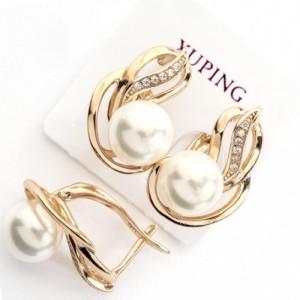 Прелестные серьги «Вивьен» с белой жемчужиной и покрытые золотым напылением фото. Купить