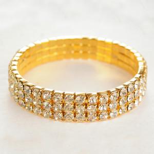 Праздничный браслет на резинке с тремя рядами бесцветных страз в жёлтом металле купить. Цена 99 грн