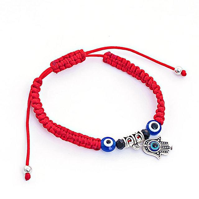 Плетёный браслет «Хамса» в виде красной нити с бусинами и амулетом купить. Цена 69 грн