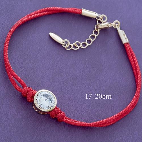 Лёгкий браслет «Карат» с круглым камнем в позолоченной оправе на красной нити купить. Цена 185 грн