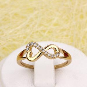 Аккуратное позолоченное кольцо «Вечность» с мелкими прозрачными камнями купить. Цена 165 грн
