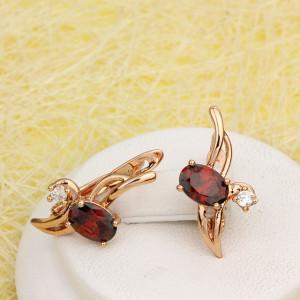 Причудливые серьги «Стрижи» с красным овальным камнем и позолотой фото. Купить