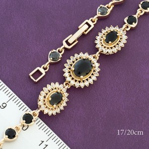 Незабываемый браслет «Роскошь» с бесцветными и чёрными фианитами в позолоте фото. Купить