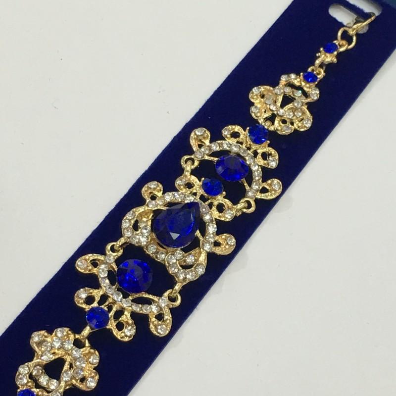 Праздничный браслет «Венецианский» ажурной формы с синими и белыми камнями купить. Цена 255 грн