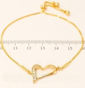 Романтичный браслет «Сердечко» с белыми фианитами и 18-ти каратной позолотой фото. Купить