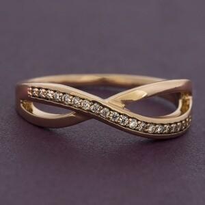 Хорошее кольцо «Бесконечность» с небольшими цирконами и позолотой купить. Цена 155 грн