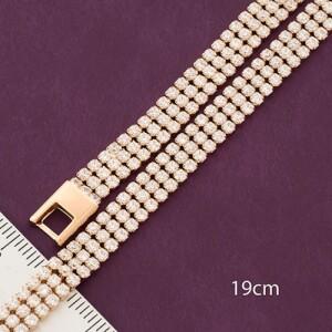 Гибкий браслет «Блаженство» с тремя рядами фианитов в позолоченной оправе купить. Цена 299 грн