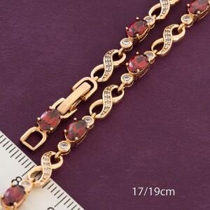 Красивый браслет «Соната» с фианитами красного цвета и золотым покрытием фото. Купить