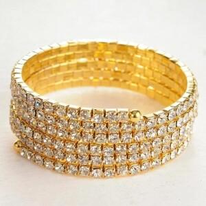 Широкий браслет-пружинка из бесцветных страз в жёлтом металле фото. Купить
