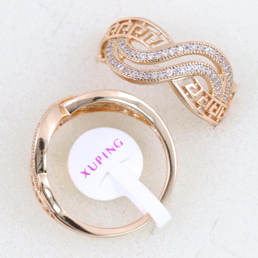 Позолоченное кольцо «Галилей» оригинальной формы с бесцветными цирконами купить. Цена 199 грн