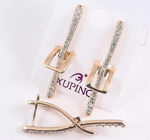 Милейшие серьги «Пряжки» современного дизайна с камнями и позолотой купить. Цена 199 грн