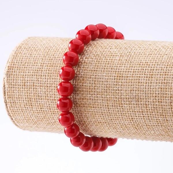Коралловый браслет из круглых бусин на резинке купить. Цена 125 грн