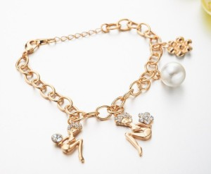 Скромный позолоченный браслет со стразами «Мулен Руж» с цепочкой и кулонами в виде женских фигурок купить. Цена 120 грн или 375 руб.