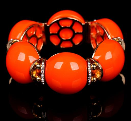 Яркий оранжевый браслет «Спелый апельсин» с золотыми вставками и белыми стразами купить. Цена 225 грн