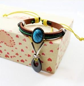 Яркий кожаный браслет «Ямайка» с жёлтым шнурком и каплевидным кулоном из гематита купить. Цена 115 грн