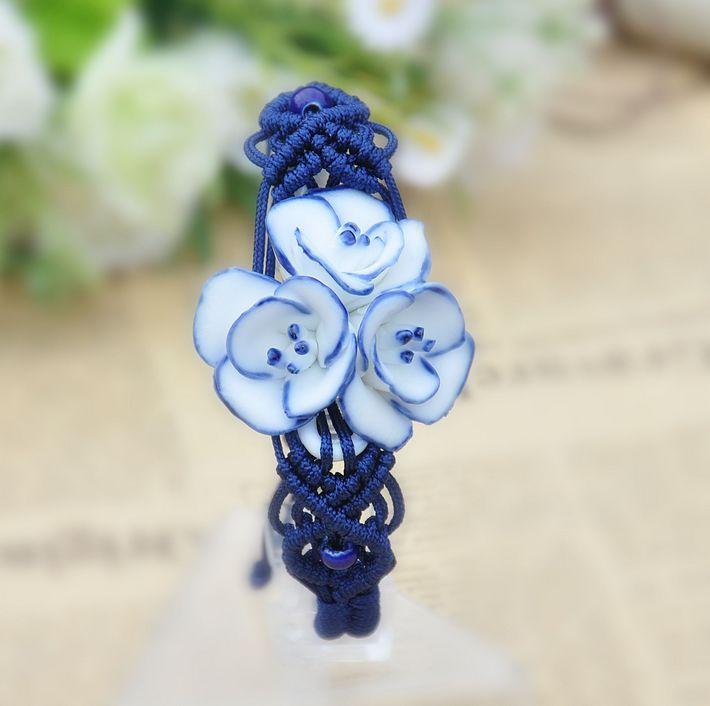 Керамический синий браслет в виде цветочка  на скользящем замке с красивым плетением из нити купить. Цена 185 грн